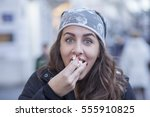 young girl eating popcorn while ... | Shutterstock . vector #555910825