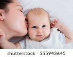 close up of a mother kissing... | Shutterstock . vector #555943645