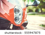 part of red sport motorcycle.... | Shutterstock . vector #555947875