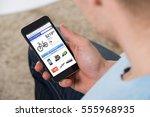 close up of man doing online... | Shutterstock . vector #555968935