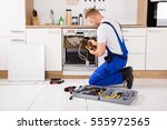 young male technician checking... | Shutterstock . vector #555972565