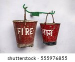 Two Fire Buckets With Red Pain...