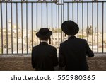 silhouettes of two jewish... | Shutterstock . vector #555980365