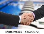 handshake of two men in black... | Shutterstock . vector #55603072