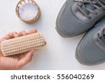 cleaning shoes washing the... | Shutterstock . vector #556040269