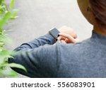 close up woman using smart... | Shutterstock . vector #556083901