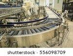 crossing of the roller conveyor | Shutterstock . vector #556098709