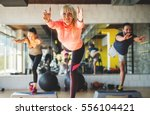 smiling athletes at fitness... | Shutterstock . vector #556104421