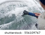 Scraping Frozen Ice And Snow...