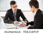 young businessmen discussing a... | Shutterstock . vector #556116919