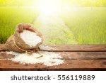 white rice in small burlap sack ... | Shutterstock . vector #556119889