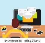 person reading email on desktop ...   Shutterstock .eps vector #556124347