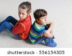 brother and sister are sitting... | Shutterstock . vector #556154305