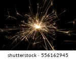 sparkler on black | Shutterstock . vector #556162945