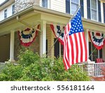 the front porch of a patriotic... | Shutterstock . vector #556181164