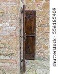 weather beaten old wooden door...   Shutterstock . vector #556185409