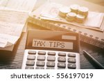 calculator with text tax tips.... | Shutterstock . vector #556197019