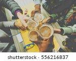 top view of friends cheering... | Shutterstock . vector #556216837
