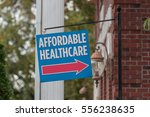 Small photo of Affordable Healthcare Sign hangs outside a building during a time when government officials are trying to improve the system