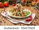 healthy grilled chicken caesar... | Shutterstock . vector #556275625