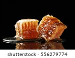 two pieces of organic honeycomb ... | Shutterstock . vector #556279774