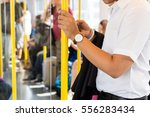 man holding the yellow handrail ... | Shutterstock . vector #556283434