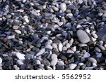 pebbles on beach background | Shutterstock . vector #5562952