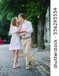 young beautiful couple walking... | Shutterstock . vector #556295554