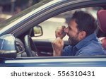 side profile angry driver with... | Shutterstock . vector #556310431