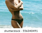 woman in dirt or dark sand on... | Shutterstock . vector #556340491