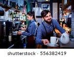 bartender waiter with a kettle... | Shutterstock . vector #556382419