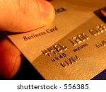 credit card in hand | Shutterstock . vector #556385