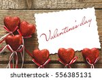 valentines day. red hearts on... | Shutterstock . vector #556385131