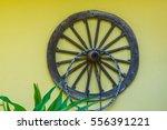 old wooden cart wheel on a...   Shutterstock . vector #556391221