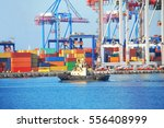 tugboat and crane in harbor... | Shutterstock . vector #556408999