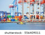 tugboat and crane in harbor... | Shutterstock . vector #556409011