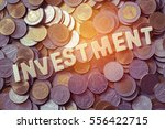 wood text investment on coins... | Shutterstock . vector #556422715