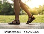 woman walking on the road | Shutterstock . vector #556429321