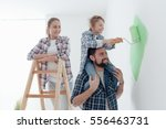 happy family renovating their... | Shutterstock . vector #556463731