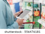 woman shopping at the...   Shutterstock . vector #556476181