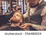 handsome bearded man is getting ... | Shutterstock . vector #556480024
