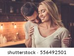 handsome man is kissing his... | Shutterstock . vector #556492501