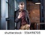 handsome caucasian businessman... | Shutterstock . vector #556498705