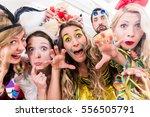 women and men celebrating at... | Shutterstock . vector #556505791