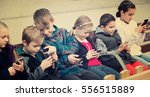 Children Sit On A Bench With...
