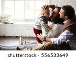 young happy family relaxing at... | Shutterstock . vector #556533649