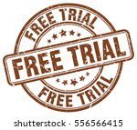 free trial. stamp. brown round...