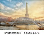 eiffel tower and a bridge over... | Shutterstock . vector #556581271