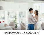 brides embrace at restaurant | Shutterstock . vector #556590871