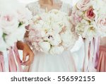 the bride with bridesmaids | Shutterstock . vector #556592155